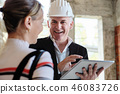 Woman Buying New Home And Talking To Broker 46083726