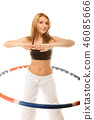 sporty fit girl doing exercise with hula hoop. 46085666