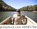Man wearing a hat rafting in the lake,mountain 46085788