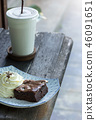 brownie cake with whipped cream and coffee 46091651