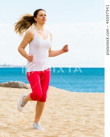 Woman running on beach 46097941