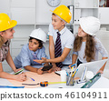 Boys and girls architects with plan 46104911