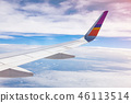 Aircraft Wing on blue sky and white clouds. 46113514