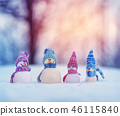 little snowmans on soft snow on blue background 46115840