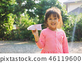 Young girl smiling and playing rocket paper. 46119600