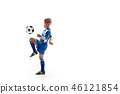 Young boy with soccer ball doing flying kick 46121854