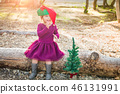 Mixed Race Toddler Girl Wearing a Christmas Hat 46131991