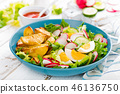 Baked potato, boiled egg and fresh vegetable salad 46136750