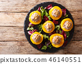 Delicious appetizer peaches stuffed with tuna 46140551