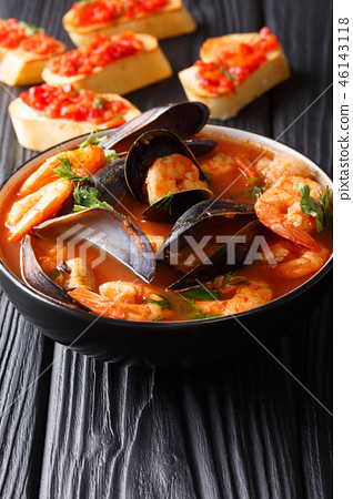 Traditional tomato seafood soup 46143118