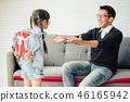 Asian daughter give present for father.  46165942