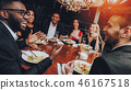 Group of Happy Friends Meeting and Having Dinner 46167518