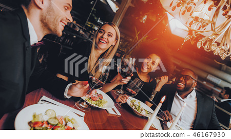 Friends Chilling Out Enjoying Meal in Restaurant 46167930