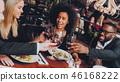 Group Happy Friends Enjoying Dating in Restaurant 46168222