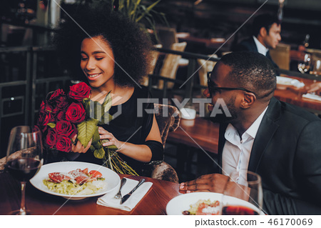 African American Couple Dating in Restaurant 46170069
