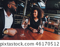 African American Couple Dating in Restaurant 46170512