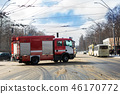 Firetruck racing through city street on slippery road at winter 46170772