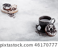 Black coffee cup with saucer and doughnuts  46170777