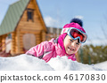 Portrait of cute ittle caucasian girl in sport winter jacket and ski goggles having fun playing 46170830