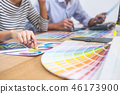 Two colleagues creative graphic designer working on color select 46173900