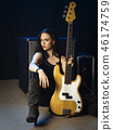 Sexy bass player sitting with her amplifier 46174759