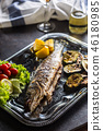 Roasted fish on dish with  grilled vegetable. 46180985