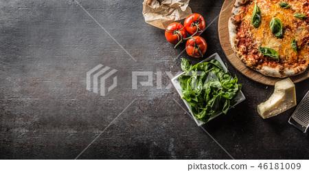Italian traditional pizza margarita on round board 46181009