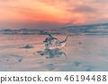 Frozen ice over freezing water lake 46194488