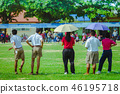 Female Teachaer is coaching children training 46195718