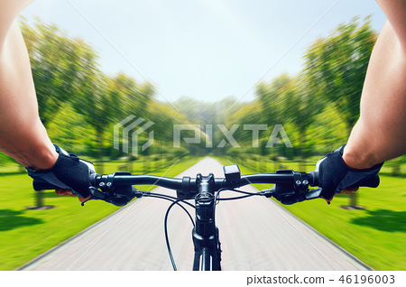 Man riding on bicycle, fast speed, aging effect 46196003