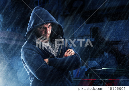 Suspect man with bruise and knocked fist in hoodie 46196005