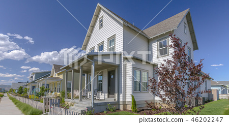 Home with porch and picket fence in Daybreak Utah 46202247
