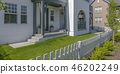 Home with lawn and white fence in Daybreak Utah 46202249