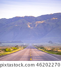Highway with view of an immense mountain in CA 46202270