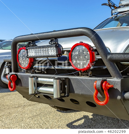 Gray SUV with grille guard and fitted spotlights 46202299
