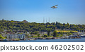 Float plane with trees building and lake below 46202502