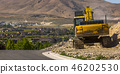 Excavator beside a road in Eagle Mountain Utah 46202530