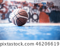 old ball on the basketball court. Indoor sport  46206619