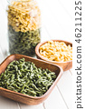 Uncooked spinach gemelli pasta. 46211225
