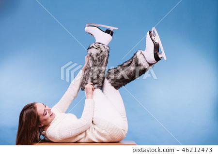Woman wearing ice skates fur socks, skating 46212473