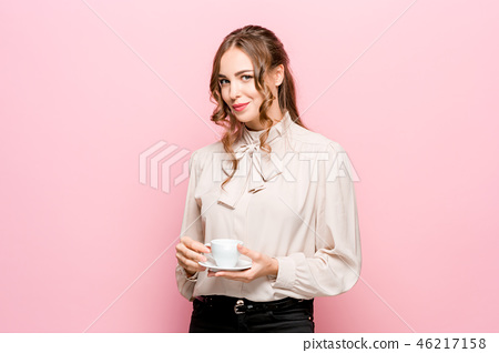 The serious frustrated young beautiful business woman on pink background 46217158