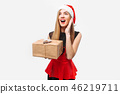 Shocked woman in a dress and Santa Claus hat 46219711