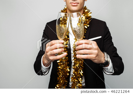 attractive man in business suit, and with  tinsel 46221264