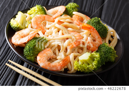 Asian style udon noodles with shrimp, broccoli 46222678