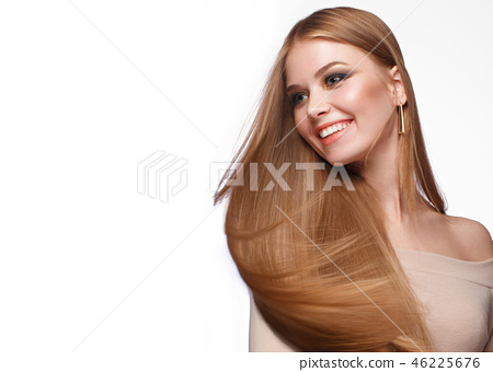 Beautiful blond girl with a perfectly smooth hair, classic make-up. Beauty face 46225676