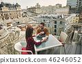 Smiling man and woman are sitting together outdoor 46246052