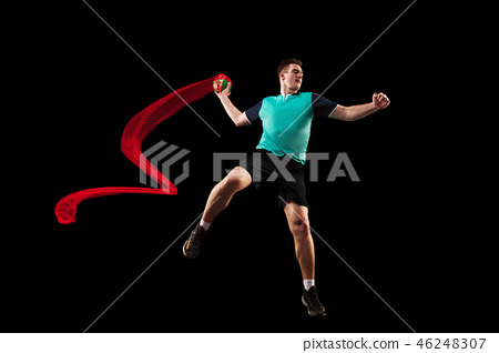 The one caucasian young man as handball player at studio on black background 46248307