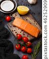Fresh raw salmon slice on chopping board  46252909
