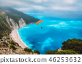 Aerial view of the paraglider flying over gorgeous Myrtos beach. Amazing water colors and beautiful 46253632