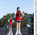 Two cheerleaders being held up by teammates 46257847